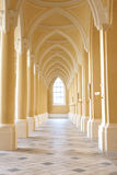 Corridor of the Peace Palace. Oriental style cream colour corridor with column and arches with tiles floring Royalty Free Stock Photography