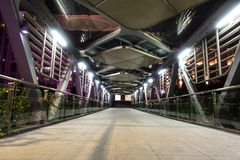 Corridor pedestrian bridge. Empty long pedestrian bridge in the modern  city at night China stock photo