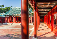 Corridor with red pillars at the Koxinga Shrine in Tainan. Taiwan Royalty Free Stock Images