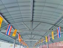 Corridor roof decorated with many flags stock images