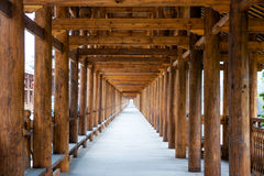 Corridor in roofed wood bridge Stock Photos