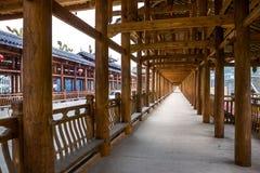 Corridor in roofed wood bridge Royalty Free Stock Image