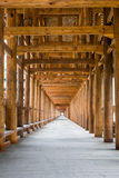 Corridor in roofed wood bridge Royalty Free Stock Image