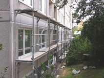 Corridor in scaffolding. Erected on concrete panel house stock images