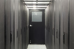 Corridor sealed with telecom racks Stock Photography