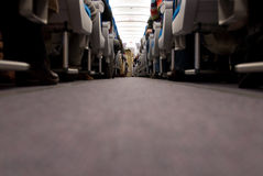 Corridor and Seats inside airplane Stock Photos