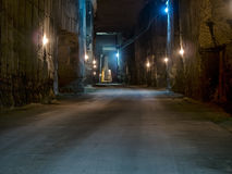Corridor in the stone quarry. Corridor in the stone quarry with mystery illuminations Royalty Free Stock Photography