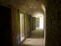 Corridor to isolation cells in an abandoned prison Stock Photos