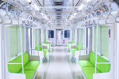 Corridor train with empty seats and handrails Stock Photos