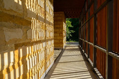 Corridor of unfinished building striped with bands of afternoon Royalty Free Stock Photos