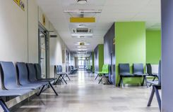 Free Corridor With Chairs For Patients In Modern Hospital Stock Photos - 104356413