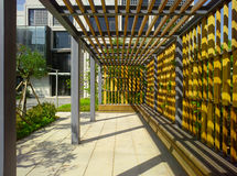Corridor of wood chairs Stock Photo