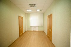 Corridor with wooden doors Royalty Free Stock Image