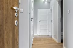 Corridor with wooden floor. In modern apartment Stock Images
