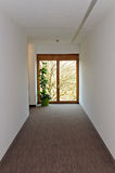 Corridor with wooden window at the end. Corridor with a view through wooden window at the end Stock Photo