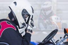 Corridore da go-kart di doppia esposizione pronto per la corsa fotografia stock libera da diritti
