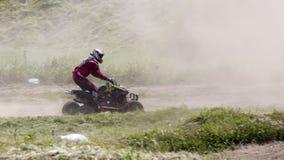 Corridore del motociclo sugli sport ATV durante il compet Fotografia Stock