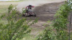 Corridore del motociclo sugli sport ATV durante il compet Fotografie Stock