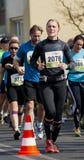 Corridore maratona della donna Fotografia Stock