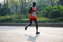 Corridore maratona internazionale di Canton Immagini Stock