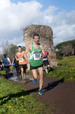 Corridori sulla pista alla maratona dell'epifania, Roma, Italia Fotografia Stock Libera da Diritti