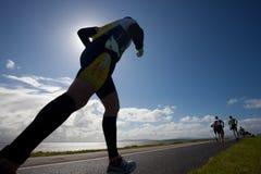 Corridori, triathlon fotografia stock