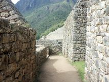 Through the corridors of Machu Picchu. In the great Inca citadel, located, Cusco. Through the corridors of Machu Picchu. A small space with stone walls, in the royalty free stock photos