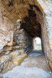 Corridors of the old fortress. Stone corridors in the ruins of an ancient fortress stock image