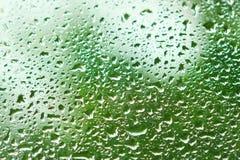 Corriente abajo del vidrio después de la lluvia Imágenes de archivo libres de regalías