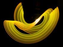 Corriente de neón de la energía del oro Imagen de archivo libre de regalías