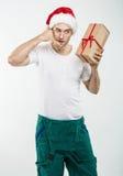 Corriere - un contenitore, un regalo e un telefono di mano Immagini Stock Libere da Diritti