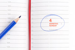 Corrija e caderno Fotografia de Stock