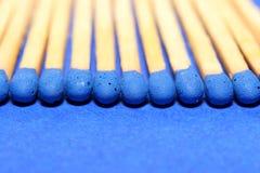 Corrispondenze blu nella riga Fotografia Stock Libera da Diritti