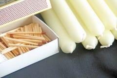 Corrispondenze e candele Immagine Stock