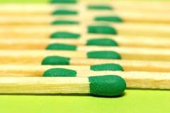 Corrispondenze verdi nella riga Immagini Stock Libere da Diritti