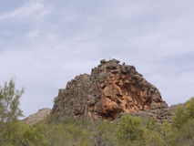 Corroboree Rock in the East McDonnell ranges. Corroboree Rock is an outstanding dark grey column of dolomite in the East McDonnell ranges in the Northern stock photo