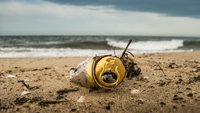 Corroded beer can on the beach. Corroded aluminum beer can littering baltic beach, Natural Reserve Mewia Lacha, Sobieszewo royalty free stock image