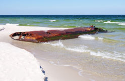 Corroded iron tank on the Baltic beach Royalty Free Stock Images