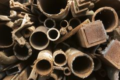 Corroded metal pipes. And black scarp royalty free stock images
