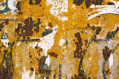 Corroded metal plate texture and poster paper scraps Royalty Free Stock Images