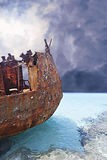 Corroded metal ship on the light blue water Stock Photography