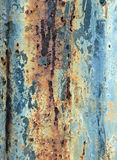 Corroded Metal Texture. A dramatic textured pattern of weathered, broken down metal, rust and paint Royalty Free Stock Photo