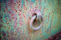 Corroded Painted Steel Background With Eye Bolt. A close up side view of a corroded metal iron steel with an eye bolt on it. The steel is painted with green Stock Images