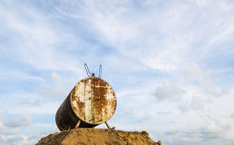 Corroded and rusty oil storage barrel against beautiful blue ski Royalty Free Stock Photography