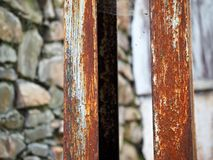Corroded steel pillars as a background. Rusted white painted metal surface. royalty free stock photos