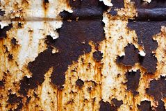 Corroded white metal background. Rusted white painted metal wall. Rusty metal background with streaks of rust. Peeling paint. Corroded white metal background stock photo