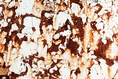 Corroded white metal background. Rusted white painted metal wall. Rusty metal background with streaks of rust. Rust stains royalty free stock image