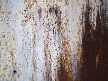 Corroded white metal background. Rusted white painted metal surface. stock photography