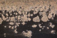 Corrosão na superfície de metal pintada preta fotografia de stock royalty free