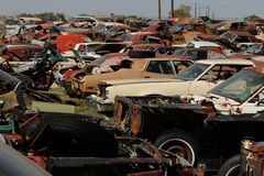 Corrosion on old dumped cars. Old broken rusty cars at recycling junkyard Stock Photo